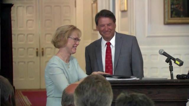 Gov. Pat McCrory and Health and Human Services Secretary Aldona Wos tear up during an Aug. 5, 2015, announcement that she plans to step down.
