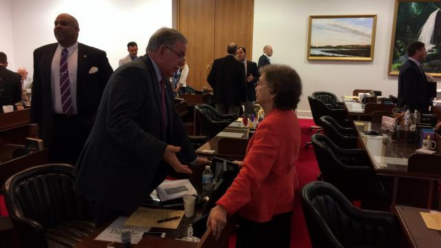 Rep. Donny Lambeth, R-Forsyth, speaks to Rep. Verla Insko, D-Orange, on the floor of the House Aug. 20, 2015.