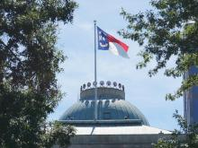 North Carolina flag flies over state capitol