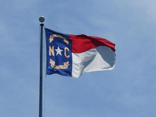 This is an image of the North Carolina state flag flying in downtown Raleigh.