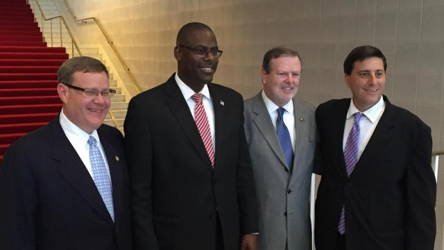 House Speaker Tim Moore, NC GOP Chairman Hasan Harnett, Senate President Pro Temp Phil Berger, and NC GOP Executive Director Dallas Woodhouse pose for a picture at the state legislative building.