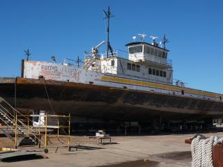 The Floyd J. Lupton, a river class ferry, sits in dry dock as workers overhaul it paint and mechanical systems. Nov. 23, 2015.