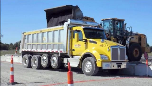 Coal ash is loaded into a truck so it can be carried away from a Duke Energy power plant and be dumped in a clay mine near Moncure.
