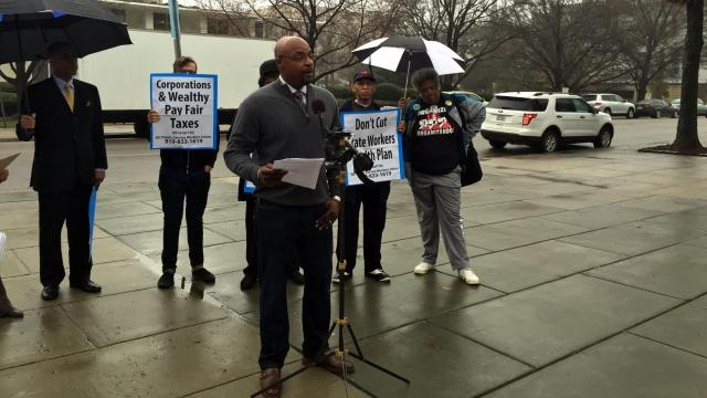 N.C. Association of Educators President Rodney Ellis speaks at a news conference on Feb. 4, 2016, across the street from the Legislative Building. The NCAE and a group representing state workers object to proposed changes in the State Health Plan.