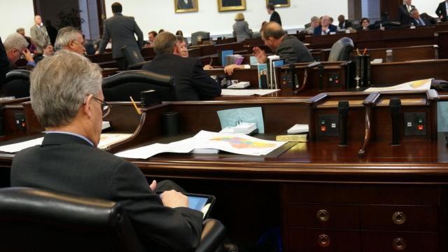 State senators wait to debate new maps for the U.S. House.