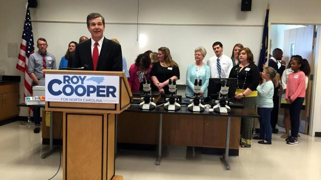 Attorney General Roy Cooper, a Democratic candidate for governor, holds a news conference on March 8, 2016.