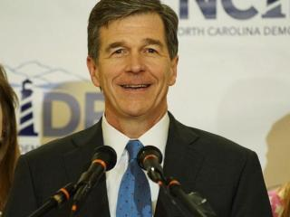Attorney General Roy Cooper celebrates his victory in the Democratic primary for governor on March 15, 2016.
