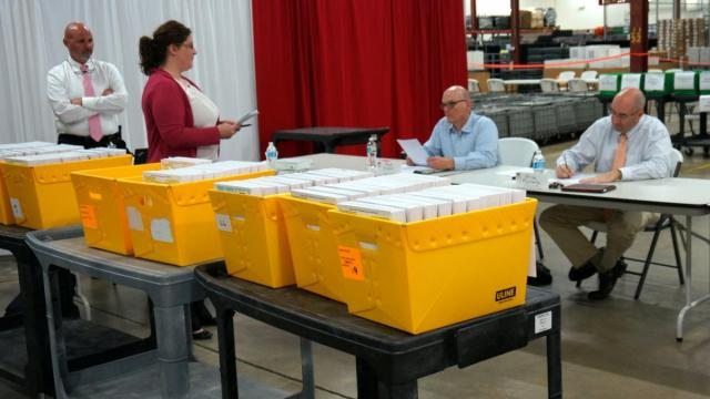 Wake County Board of Elections Chairman Brian Ratledge (right) and Mark Ezzell (seated, middle) examing provisional ballots during the Wake County canvass as Elections Director Gary Sims and  Deputy Director Nicole Shumaker look on.