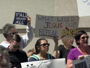 Opponents to North Carolina's new discrimination law protest in downtown Raleigh on April 11, 2016.