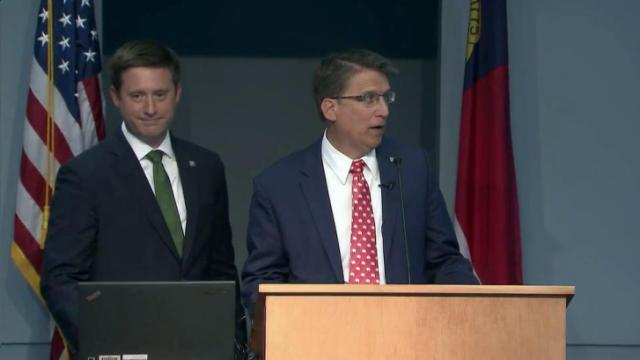 Gov. Pat McCrory, right, and budget director Drew Heath discuss McCrory's proposed 2016-17 state budget at an April 22, 2016, news conference.