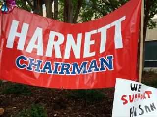 A banner outside the McKimmon Center supports GOP Chairman Hasan Harnett as members of the N.C. Republican Party meet inside to decide whether to remove him from his post.