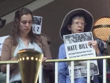 Demonstrators protest inside Legislative Building