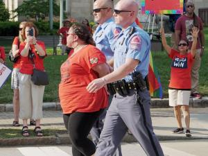 After marching more than 20 miles over two days to press lawmakers for more education funding in the state budget, several teachers were arrested Wednesday evening while sitting down in the middle of Morgan Street outside the State Capitol.