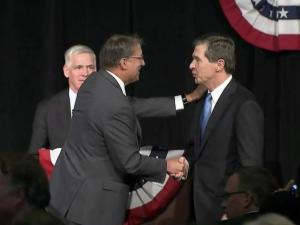 Gov. Pat McCrory, left, and Attorney General Roy Cooper shake hands after their first gubernatorial debate on June 24, 2016.