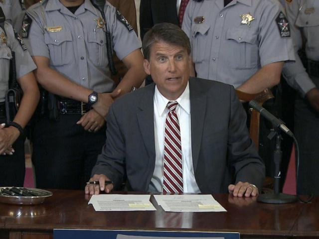 Gov. Pat McCrory signs legislation on July 11, 2016, that sets rules for access to footage from police body and dashboard cameras.<br/>Photographer: David McCorkle