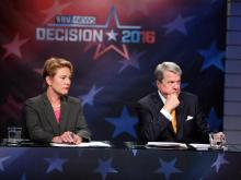 Moderators Laura Leslie and David Crabtree of WRAL News listen to candidate responses during an Oct. 18, 2016, gubernatorial debate. (Photo by Al Robinson/WRAL)