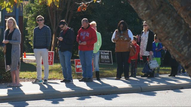 Voters line up outside Dillard Drive Elementary in Raleigh on Nov. 8, 2016.