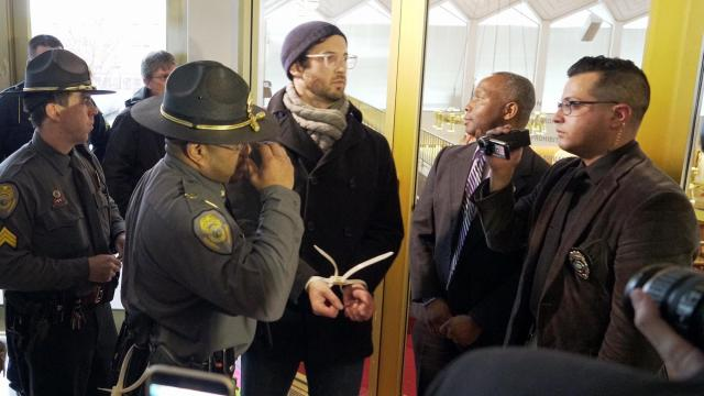 Members of the General Assembly Police arrest a protester outside the Senate visitors' gallery.