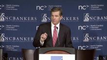 Cooper addresses business leaders