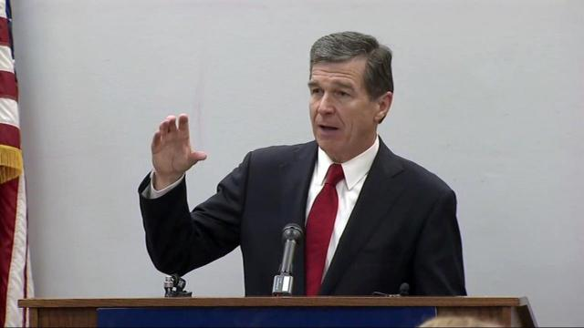 Gov. Roy Cooper unveils his first state budget proposal during a March 1, 2017, news conference.