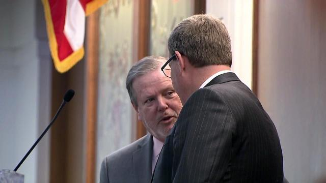 Senate President Pro Tem Phil Berger, left, confers with House Speaker Tim Moore.