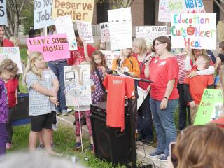 Teachers worried that they could lose their job as a result of a law intended to lower class sizes in kindergarten through third grade rallied Wednesday afternoon outside the state Legislative Building.