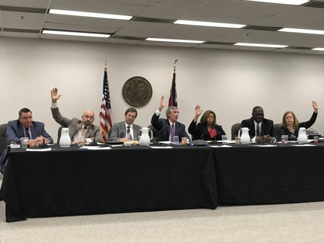 One of several deadlocked votes Wednesday, March 21, 2018, for the new N.C. State Board of Elections and Ethics Enforcement. Republicans and Democrats on the board took several 4-4 votes before agreeing on two nominations as the board's potential ninth member. One GOP member is not pictured and participated in the meeting by telephone.<br/>Reporter: Travis Fain