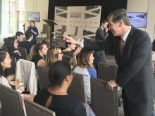 Gov. Roy Cooper greets students at Duke University before a Q&A March 29, 2018.
