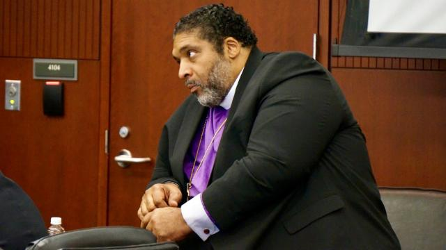 Rev. William Barber listens to testimony in his trespassing trial on June 5, 2019.
