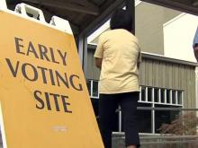 Voters line up in rain for second day of early voting