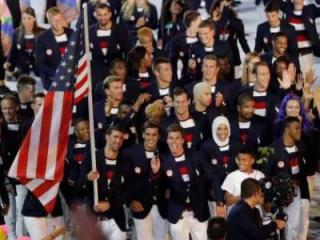 Ibtihaj Muhammad is in the front line of USA Olympians as they march in the opening ceremonies of the Rio games.