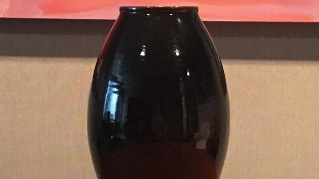 Vase by N.C. artisan Ben Owen III is a gift from Capitol Broadcasting Company to PayPal.