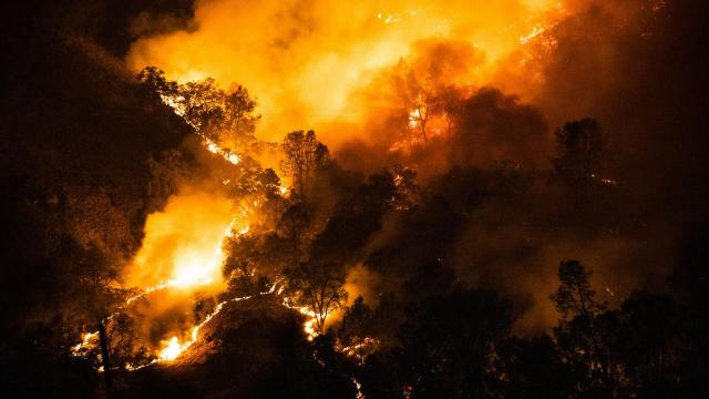 """FILE -- The Glass Fire burns above Calistoga, Calif., early Tuesday, Sept. 29, 2020. """"For anyone who cares about the health of the planet, the Trump years have been, to say the least, profoundly discouraging,"""" writes Robert B. Semple Jr. (Max Whittaker/The New York Times)"""