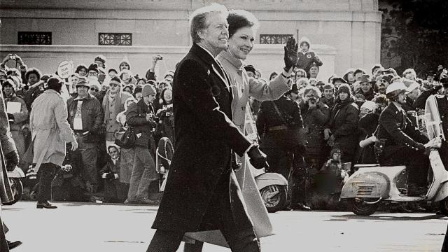 President Jimmy Carter and his wife Rosalynn Carter, walk up Pennsylvania Avenue in Washington, D.C. after his inauguration in 1977.  (Photo by Ken Cooke, The Fayetteville Times)