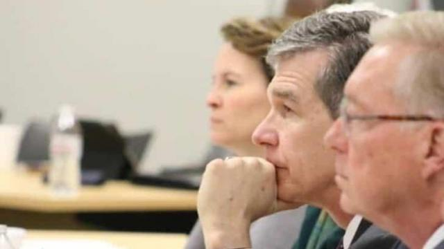 N.C. Gov. Roy Cooper(middle) and Commission on a Sound Basic Education Chair Brad Wilson (right) 09-28-2021