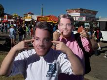 Can you spot the real Greg Fishel? Masks of WRAL's chief meteorologist abound at the State Fair.