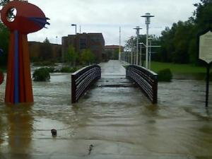 Cross Creek rises over a bridge in downtown Fayetteville's Festival Park on Saturday, Sept. 6, 2008.