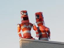 The Barrel Monster has returned to Hillsborough street, this time holding hands with Mrs. Barrel Monster.  The lovely couple are overlooking the street scene and the NC State University campus from the rooftop at 2526 Hillsborough Street.  Photo was taken in late afternoon, Wednesday, October 7, 2009.