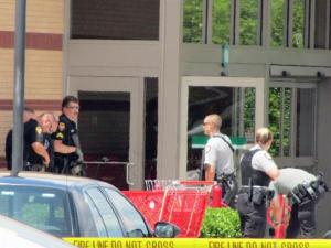 Authorities prepare to enter the Target in Apex after a shooting on May 30, 2010.