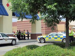 Authorities investigate after a shooting at the Target in Apex on May 30, 2010.