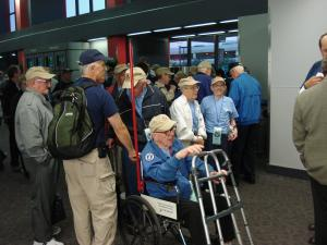 Scenes at RDU this morning as 100 World War II veterans arrive for their flight to Washington.