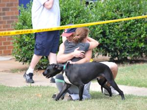 Man saves his dog from burning apt then hugs his girlfriend. Photo submitted by Chas Bridwell.