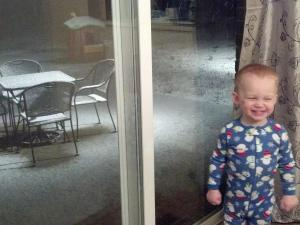 Elliott was so excited that Mommy got him out of bed to see the snow falling.