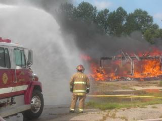 The Clayton Fire Department does a controlled burn at an abandoned building on Saturday, June 2, 2012. (Photo courtesy of Lee Odom)