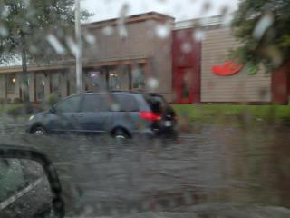 Cross creek mall entrance off morganton road between chilis and red robin got flooded and a vehicle got stuck