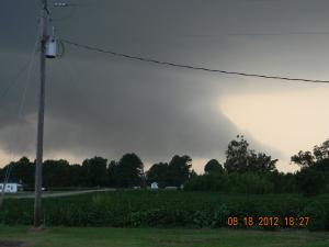 storm clouds produced heavy down pour, hail, strong gusty winds.