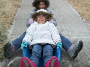 Finding a way to sled, even if we didn't get much snow!!