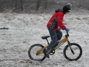 A boy rides his bike in the snow in Semora.