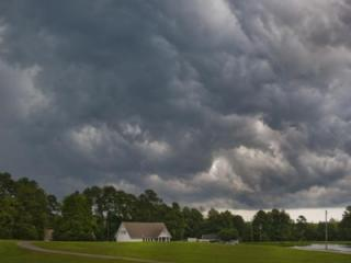 Playing golf at Zebulon Country Club.  Storm roared in about 12:44pm.  This is looking back at the club house from #1 hole