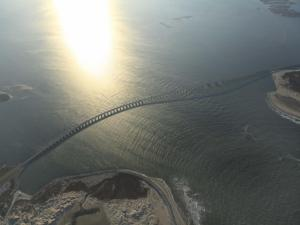 An aerial photo taken on Nov. 30, 2013, shows the thin link that the Bonner Bridge provides across Oregon Inlet between Hatteras Island and the North Carolina mainland. (Photo courtesy of Charlie Sarratt)